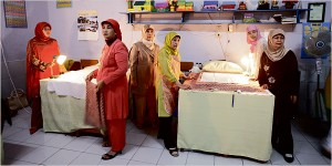 Female circumcisers and their attendants waiting to start the procedure